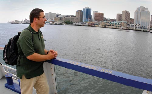 Gary Smith on the Ferry with Halifax skyline in BG.JPG