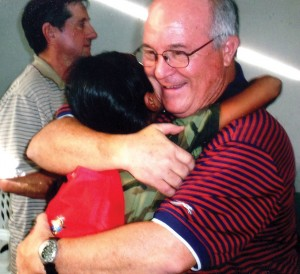 Merideth gets a hug while serving on a mission trip in Guatemala.