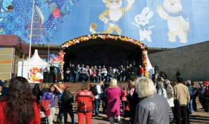 The men sing in the Mayor's Park in Sochi with the official Olympic mascots providing.