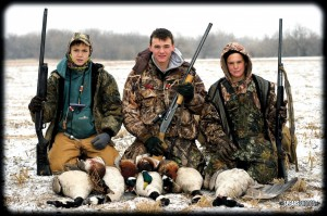 From left, Dakota Craig, Nick Spears and Dallas Craig share the results of their hunt. The young men participate in Team Blind Faith, a Christian discipleship program that is incorporated while they are hunting.