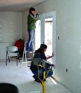 Students from Nicoma Park, First put finishing touches on sheetrock walls inside the new caretaker's living space.