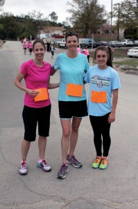 The top three finishers of the 2014 Women's Retreat 5K are pictured, including a new retreat record set by 13-year-old Madalyn Harper, right, with a time of 23:18.
