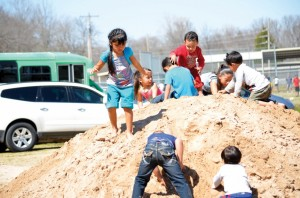 while older youths played organized sports, young children had just as much fun playing on a pile of dirt.