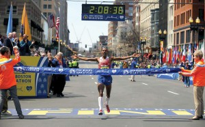 photo: world news service Meb Keflezighi crosses the finish line to win the Boston Marathon.