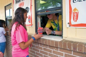 An ACC camper observes a Falls Creek tradition, as she receives one of the first Icees of the summer.