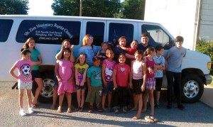 Jeffrey and Amy Willoughy, back row, gather children in front of the  van recently donated to Michigan Ave.  (Photo: Provided)