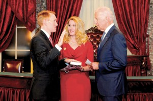 U.S. Sen. James Lankford (R-Okla.), left, takes his oath of office on Jan. 6 before U.S. Vice President Joseph Biden, as Lankford's wife, Cindy, looks on. Lankford, a Southern Baptist minister who served as Program Director for Falls Creek, is one of many Southern Baptists serving in Washington, D.C. in the 114th Congress. (Photo: Provided)