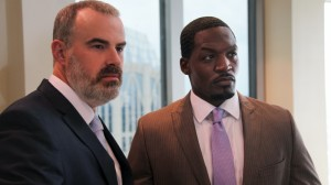 Coleman (Alex Kendrick) stands with Tony (T.C. Stallings), his top pharmaceutical salesman, after a tense board meeting in downtown Charlotte. (Courtesy of AFFIRM Films/Provident Films, Photo: Judd Brannon)