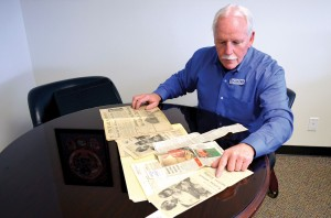 Lowrey looks through newspaper clippings about his ordeal 40 years ago from a file in the Baptist Messenger office. (Photo: Bob Nigh)