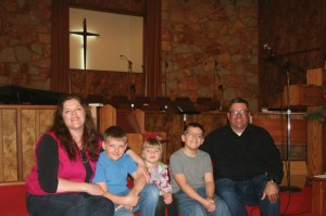 Chad and Anna are pictured with their three children, Sean, Ruby and David.