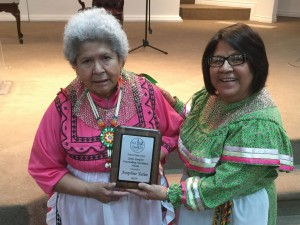 Josephine Teehee, of the Mississippi Choctaw tribe, left, received the inaugural choir award, Jamie Sumpter Outstanding Attendance Award, 2014 from Augusta Smith, Native American LINK executive director & Native Praise Choir coordinator