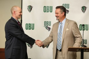OBU Athletic Director Robert Davenport, right, welcomes new Bison men's basketball coach Quinn Wooldridge (Photo: Bill Pope)