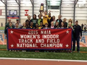 The OBU women's track team display their 2015 NAIA Indoor Track & Field National Championship Banner