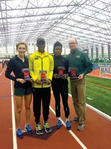 From left, Women's Outstanding Performer Hannah Fields; Men's Outstanding Performer Travis Hinton; Women's Most Valuable Performer Elizabeth Dadzie and Women's Coach of the Year Ford Mastin.