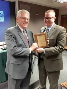 Anthony L. Jordan, BGCO executive director-treasurer, accepts an award from a national professional engineering society for excellence in design of the new Falls Creek wastewater treatment facility from Operations Team leader D. Scott Phillips, who has been overseeing Falls Creek construction and projects (Photo: Brian Hobbs)