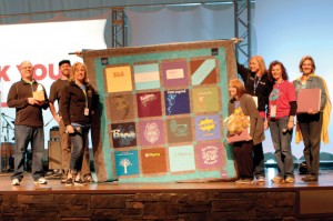 Kelly King, third from left, was honored for her 10 years of service, receiving a quilt made up of event T-shirts over the years (Photo: Tiffany Zylstra)