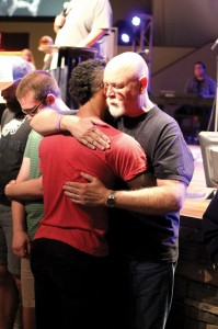 Mike Story, Director of the Oklahoma State University BCM, prays with a student (Photo: Tiffany Zylstra)