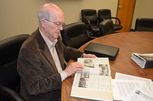 Williams looks through articles about the bombing in file copies of the Baptist Messenger from 1995 (Photo: Bob Nigh)