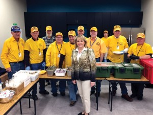 Oklahoma Governor Mary Fallin poses with Disaster Relief volunteers who served lunch at the oil workers job fair