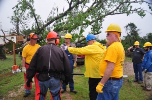 Team leader Deyrl Kastner (Blue hard hat) sets the team in motion in Bridge Creek. (Photo: David Crowell)