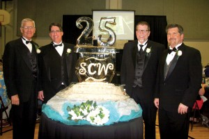 Lind, right, poses with former directors, from left, Bill Green, Bart Morrison and Ken Gabrielse around the special 25th Anniversary ice sculpture (Photo: Dana Williamson)