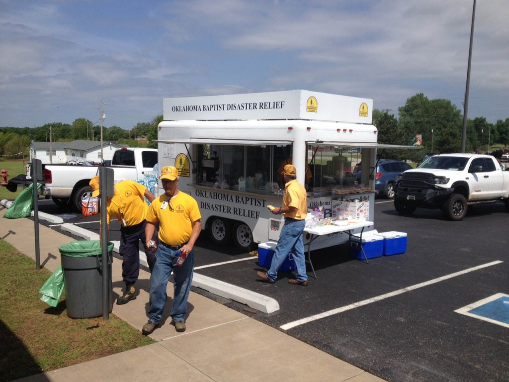 Oklahoma Baptist disaster relief volunteers serve meals on Thursday to victims and volunteer workers, at Snow Hill Baptist Church near Tuttle. (Photo: Brad Biddy)