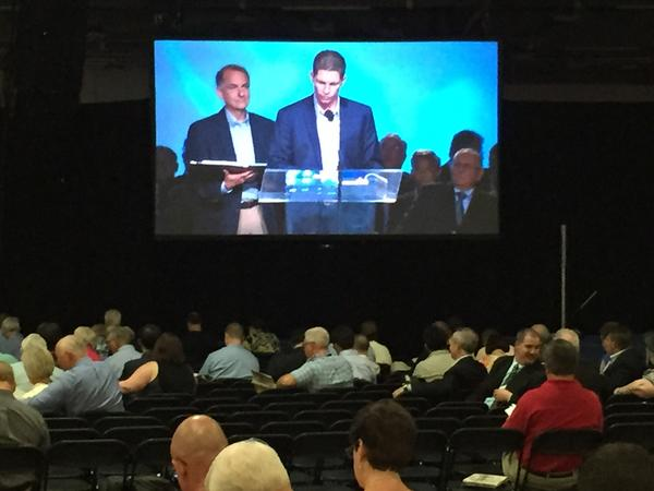Oklahoma Pastor Shane Hall of First Southern Baptist Church in Del City presents a motion at the #sbc15.