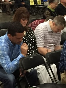 From left, Pastor Will Wilson, Jr. of Tecumseh, New Hope, and Lana and Pastor Doug Melton of Oklahoma City, Southern Hills, participate in a prayer time at the SBC meeting (Photo: Brian Hobbs)