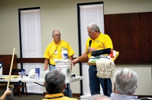 Brown and Sam Porter, Baptist General Convention of Oklahoma disaster relief director, demonstrate items that can be used to clean out and sanitize a home or business that has been contaminated by floodwaters. Other such classes were held in Bixby, Durant, Elk City, Lawton and Poteau. (Photo: Bob Nigh)