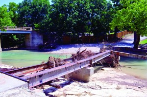 The bridge over Honey Creek at CrossTimbers Children's Mission Adventure Camp was washed out by rushing waters; fortunately, there are two gates to the camp and access is still available for campers. (Photo: Bob Nigh)8