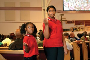 "It was ""Children's Day,"" and youth served as ushers, helping attendees find seats. (Photo: Bob Nigh)"