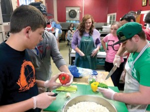 Portland team helps church prepare a meal for people in need (Photo: Provided)