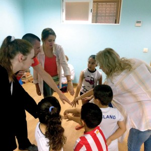 Members of Madrid team teach children a rally cheer at English Camp. (Photo: Provided)