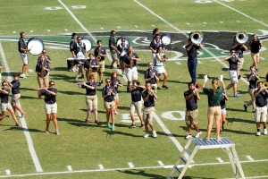 Drum Major Kathleen Houston, a junior elementary education major from Keller, Texas, leads the Bison Brigade from the podium in her second year as drum major. (Photo: Bill Pope)
