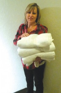 photo: provided Jana Hughes, children's director,  provides towels for candidates.