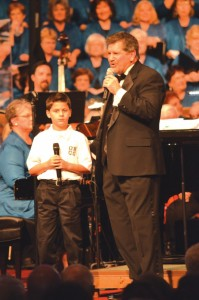 (photos: bob nigh) Oklahoma Baptist Children's Choir member Cody Ware is introduced by SCM/SCW director Randy Lind before singing as part of a trio with SCW members Dru Baker and Stacie McCracken