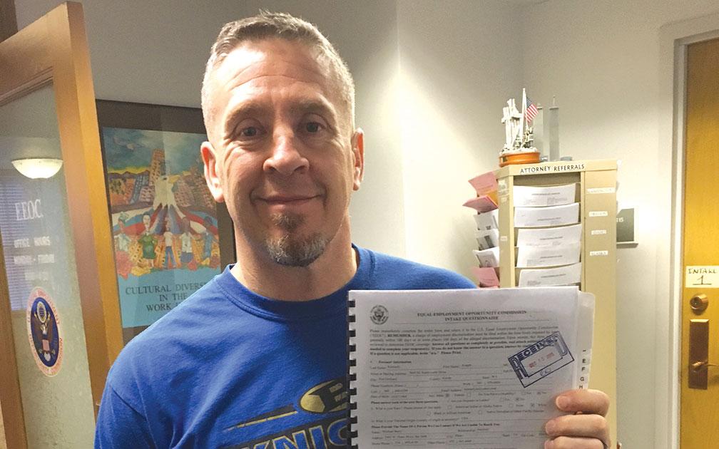 Suspended coach files discrimination complaint