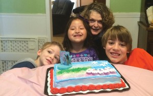 photos: provided Chloe Gattis, with her mom, TeAta, and family shows off her 6th brithday cake.
