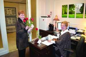 A Rose Day participant delivers a rose to Sen. Rob Standridge's office (Photo: Chris Doyle)