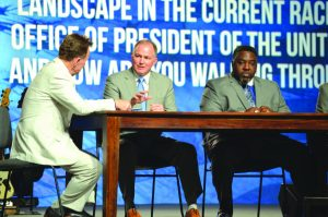 """Hance Dilbeck, second from left, answers a question posed by Ronnie Floyd, left, on the panel discussing """"Pastors and The Church in American Politics Today."""" A.B. Vines, pastor of Spring Valley, Calif., New Seasons, right, listens (Photo: Brian Hobbs)"""