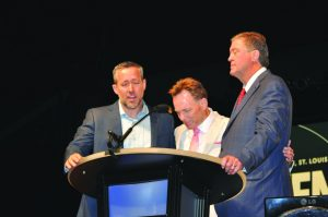 "From left, J.D. Greear, Ronnie Floyd and Steve Gaines demonstrate a ""moment of unity"" in prayer at the SBC annual meeting. Gaines won the residential election, as Greear resigned as a candidate (Photo: Jennifer Rash)"