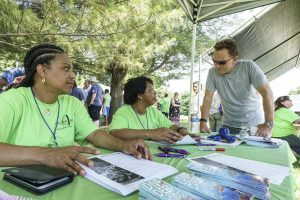 (Left to right) Catherine Corpus and Lina Freeman, members of Idlewild Baptist church in Lutz, Fla., visit with Ronnie Floyd, president of the Southern Baptist Convention, during a block party at Sterling Baptist Church in Fairview Heights, Ill. The block party was part of Crossover St. Louis 2016, held prior to the annual meeting of the Southern Baptist Convention June 14-15 at America's Center in St. Louis. (Photo: Matt Miller)