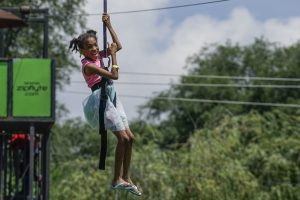Ten-year-old Jasmine rides a zip line at a block party hosted by Sterling Baptist Church in Fairview Heights, Ill. The block party was part of Crossover St. Louis 2016, held prior to the annual meeting of the Southern Baptist Convention June 14-15 at America's Center in St. Louis. (Photo: Matt Miller)