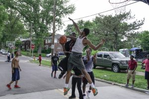 The Gate Church set up basketball courts for residents at Kingsland Park in University City, Mo., during Crossover St. Louis 2016. According to a local pastor, the park has been plagued by drug use for the past several years and The Gate Church hopes to help reclaim the area for the citizens. (Photo: Bob Carey)