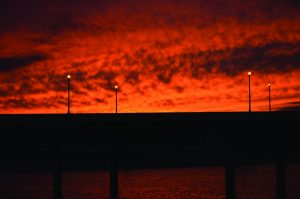 The sky is ablaze above a Western St. bridge in Oklahoma City.