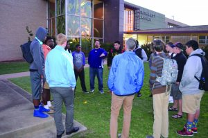 Tony Mullican, student pastor at Oklahoma City, Portland Avenue, center, speaks to Northwest Classen High School students during SYATP prayer gathering. Photo: Chris Doyle