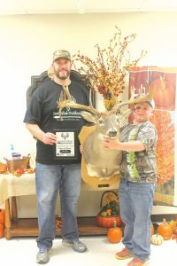 "Trevor Hill, received a plaque for Murl Looper for ""Biggest Buck."""