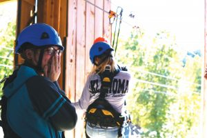 Students enjoying zipline
