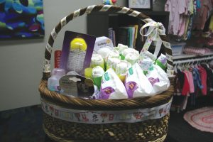 A gift basket inside the boutique where mothers can use points earned in educational classes to shop for their children