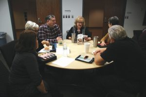 Cathy Price, BGCO Church Planting ministry assistant, center, reads her Legacy Letter to her table mates during an At-Home Day session at the Baptist Building